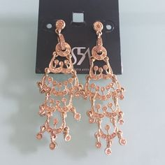 Gold Earrings The perfect accessory to dress up your look! Perfect/new condition. Saks Fifth Avenue Jewelry Earrings