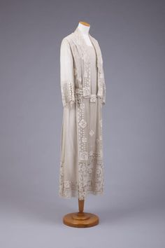 1924 Cream Silk Chiffon Dress With Pointed Collar Of Lace. Bold and Thick Machine Embroidery Front and Back. Lace Panels In Back, At Sleeve Cuff and At Base Of Hem, Roses have a Charles Rennie Mackintosh feel