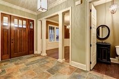 Slate tile has been laid in the entry foyer of this home by Louisville Custom Builder Stonecroft Homes. by Stonecroft Homes, via Flickr
