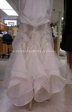 Bustles on wedding gown drawn up like an Australian / Roman shade.  This photo is with the bustle inside-out so you can see what was done.