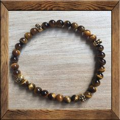 #PROTECTION #Mala: #KARMA #GEMSTONE: Tiger Eye + Skulls - #TIGEREYE lets you see everything. It stimulates taking #action, and helps you to make decisions with discernment and understanding, and unclouded by your emotions. The #SKULL is one of the oldest and most powerful of all symbols. Skulls symbolize #protection, #strength, #power, #fearlessness, #wisdom and #guidance, and #surviving through a difficult time.