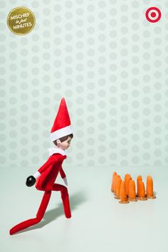Don't look now, but our Elf On The Shelf has turned a fridge shelf into a private bowling alley with baby carrots as pins and an olive bowling ball. Elf-styling tip: to help an Elf stand, you can brace him with pipe cleaners, or just prop him up next to a wall or sturdy gallon of milk.