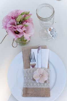 Super sweet and super simple wedding place setting - i dont like the flowers on the side, but i like the napkin/silverware holder