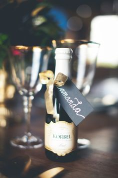 Mini Champagne Bottle Place Card | photography by http://onesummerdayphoto.com/