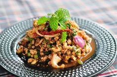 Larb Moo Thai Spicy Minced Pork Salad with Green Vegetables and Chilis