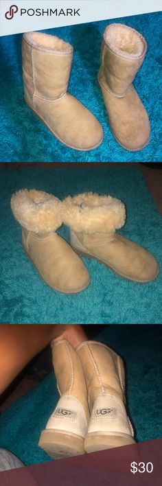 Short Ugg Boots Super comfy and soft tan short Ugg Australia boots; SIZE 4 (posh doesn't have a size 4 option);fluffy inner layer; super cute to roll over and have fluffy ankle boots!; slight ware, as shown in photos, but otherwise great condition! UGG Shoes Winter & Rain Boots