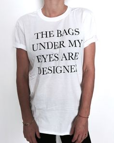 Welcome to Nalla shop :)  For sale we have these great The bags under my eyes are designer t-shirts!   With a large range of colors and sizes - just select your perfect choice from the drop down menus!    The Sizes and Dimensions are as Follows for the womens fitted Small (6 - 8): Pit to Pit - 16, Length 24. Medium (10 - 12): Pit to Pit -17,5, Length - 25. Large (14 - 16): Pit to Pit - 19, Length - 26. Extra Large (18 - 20): Pit to Pit - 21.5, Length - 27. Product Info:  100% semi-combed…