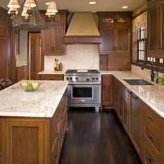 Kitchen Design Ideas With Oak Cabinets kitchen of the day this small kitchen features traditional rich cherry cabinets light green walls and light wood floors set at an angle phot Find This Pin And More On Home Decor Decorating Ideas Darker Wood Floor Kitchen Color Of Granite For Oak Cabinets Design