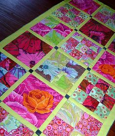 Kaffe Fassett fabrics were used in this lovely table runner.
