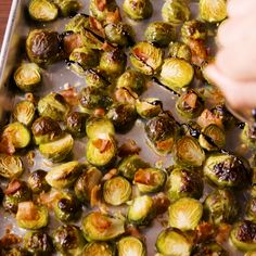 These Brussels sprouts are easy enough to make on a weeknight but fancy enough to serve at a dinner party. Instead of roasting the sprouts with balsamic vinegar (which would make them soggy and mushy) we make a simple balsamic glaze to garnish them with. Get the recipe at Delish.com. #delish #easy #recipe #Brusselsprouts #brussels #bacon #Balsamic #glaze #roasted #vegetarian #crispy #honey