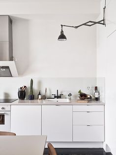 white kitchen, black floor | Scandinavian Retreat | original source: stadshem.se