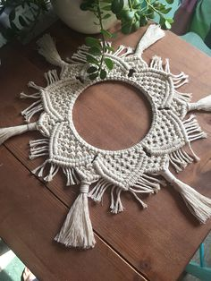 MODERN MACRAME TABLE CENTREPIECE / PLANT SKIRT Unfettered Co specializes in handmade modern fibre art and bohemian macrame statement pieces designed to fill your home with warmth, texture, whimsy, and dimension. CREATION STORY: This piece is designed to dress up any table. It works well