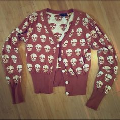 Burnt orange skull cardigan Size small. Burnt orange skull print cardigan. No PP or trades. ModCloth Sweaters Cardigans