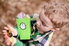 Pin for Later: Finding the Pot o' Gold: A St. Patrick's Day Party Filled With Treats For All Gold Coins A lil leprechaun and the treasures he found. Source: Jenny Cookies