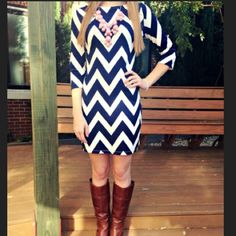 🎀 Navy Chevron Dress 🎀 UPDATE: Ripped the tags off this and wore it. Now considering keeping. Let me know if interested... Sadly, my passion for pretty things and the practicality of working from home don't often coexist. This is a purchase from a fav Posher that I just haven't reached for. It's truly lovely. 💞  I am a 4/6, and it fits me great.  First photo shows fall styling options. Actual dress is the second photo. Boutique Dresses