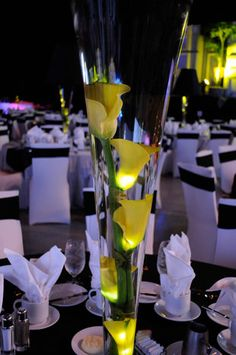 black and white table setting w/ yellow calla lily centerpiece
