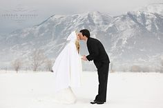 winter wedding with bride in ivory dress with pure white cape