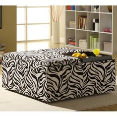 animal hide chairs for living room   Living room furnishings with zebra prints, black and white ottoman and ...