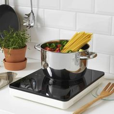 tillreda on counter| portable stovetop can eliminate the need for a bulky stove/oven in a tiny home. Bonus: can be used anywhere with access to electricity (possibly help families cut down on inhalation of wood smoke if that is their primary cooking source?)