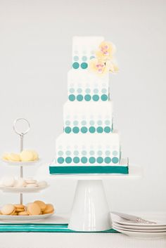 Bobbette & Belle Modern Dot wedding cake. The dots on this cake add a touch of whimsy while the square shape and sugar orchids create a chic and modern look.