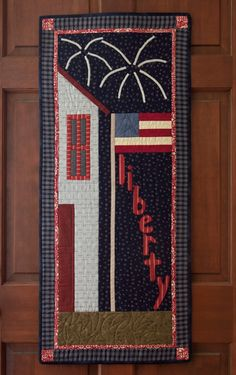 Hang this Americana-style quilt for the 4th of July! Download the free Liberty Door Banner pattern, designed by Avis Shirer and Tammy Johnson.