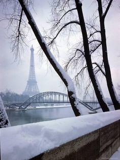 Snowfall in Paris: Passerelle Debilly and Eiffel Tower Photographic Print by Dmitri Kessel at Art.com
