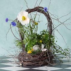 """Hand-crafted from natural birch twigs, this wild woodland basket makes a beautiful centerpiece for springtime décor.- Birch stems, floral wire- Indoor or outdoor use- For best longevity, handle gently and avoid direct sunlight or moisture- Natural materials; color variance may occur- Handmade in the USASmall: 13""""H, 9.5"""" exterior diameter, 6.5"""" interior diameter Large: 18.5""""H, 12"""" exterior diameter, 9"""" interior diameter"""