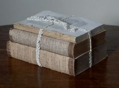 Could add to centerpiece?  Antique French Book Bundle Vintage Wedding Decor by Spellbinderie, $20.00