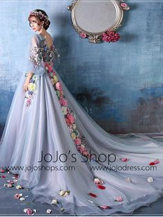 Inspired by the Oscar red carpet evening dress, this beautiful misty blue ball gown accented with hand made flowers will make you the center of attention. This