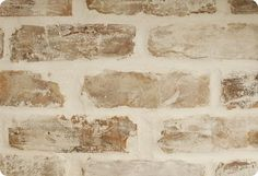 DIY: Believe it or not, but this is faux brick! This tutorial will explain how to get this look. These faux brick sheets are a great way to add interest to a room or to cover up a damaged wall.