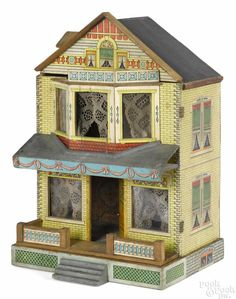 Attributed to Bliss, paper lithograph over wood doll house with a dormer and a front porch, 19'' h. - Price Estimate: $300 - $500