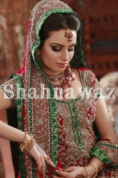 Pakistani/Indian silverish gold bridal jewelry with red stones (zevar): Necklace, tika, and long earrings