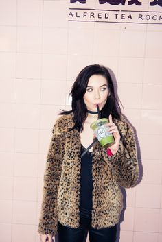 Amanda Steele's Ideal L.A. Day Includes Matcha And Saint Laurent:  A few iced beverages from Alfred, some serious shopping on Fairfax and Rodeo Drive, and lots of impromptu photo moments and beauty tips from Steele.  -- Fur cheetah print jacket and black choker.  | Coveteur.com