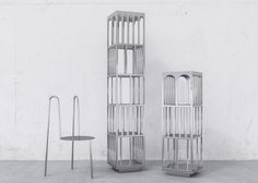 The six-piece collection comprises powder-coated steel chairs and free-standing shelves, all of which are made in Brooklyn. The shelves come in two different heights, and feature cut-out shapes that form a surrounding cage.