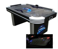 """The Triumph 72"""" Lumen-X Air Hockey is one the latest addition in the Triumph line of Air Hockey Tables. With it's black futuristic design, this table is great addition to every game room. Product feat"""
