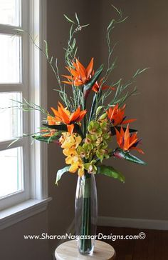 """Tall Wedding Centerpiece.  Call or email for prices. Any design shown can be customized upon request.  Birds of Paradise and Orchids.  Yellow / orange / green.  Size: 33"""" tall, 16"""" wide.  Design # T1130128"""