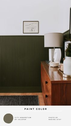 Hunter green home inspiration - green wainscoting with vertical wood slats. Bedroom or office wainscoting ideas. My favorite hunter green paint color and and home decor. All the olive green, hunter green, and army green home ideas. | Nadine Stay #officedecor #vintageart #wainscoting #huntergreen #greenpaint #verticalshiplap #huntergreenroom #bedroomideas #officedecorinspiration