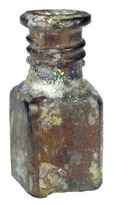 Roman glass :    Miniature brown glass bottle with a rectangular shaped body, indented base, rolled rim, some iridescence and encrustation.  50 - 100 AD