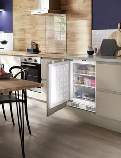 An integrated freezer is the perfect solution to hiding kitchen appliances and keeping the look of your kitchen. Take a look at Howdens for kitchen ideas. Integrated Fridge, Hidden Kitchen, Kitchens, Kitchen Appliances, Kitchen Collection, Kitchen Handles, Storage Cabinets, Cabinet Doors, Freezer