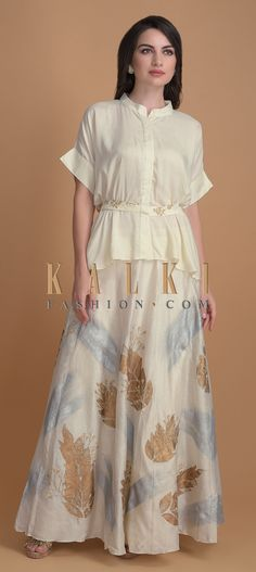 Cream white skirt in cotton silk with foil and zari in leaf motifs. Paired with a peplum top in cotton with a zari embroidered belt. Indian Dresses, Indian Outfits, Bollywood Dress, Long Gowns, Ear Rings, Anarkali Suits, Indian Designer Wear, Mandarin Collar, Cream White