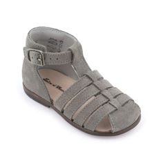 Taupe sandals made of suede leather. Ergonomically-designed insoles made of leather. Strengthening patches at the back of the shoe. Adjustable ankle strap with a buckle. Elastomere gum outsoles. - $ 100.00