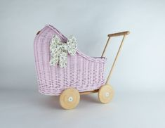 Wiklibox wicker & alder wood doll stroller in Light Pink colour with a soft muslin bedding. Variants available Ecological paint. Baby walker by WIKLIBOX on Etsy Dolls Prams, Light Pink Color, Wicker, Baby Strollers, Little Girls, Etsy, Vintage, Children, Wood