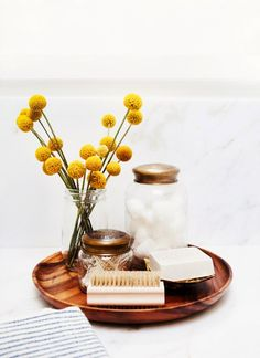 Store your toiletries in hurricane jars.