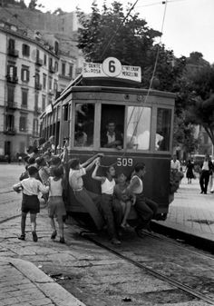 david seymour(1911-56), naples. These young Neapolitans like the danger of the strictly-forbidden practise of hanging onto the backs of street cars. http://www.magnumphotos.com/C.aspx?VP3=SearchDetail&VBID=24PVHE8WZMI1&PN=72&IID=2S5RYD12LIEO; http://www.magnumphotos.com/C.aspx?VP3=SearchDetail&VBID=24PVHE8WZMI1&PN=59&IID=2S5RYDWMSJTG