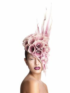There's no denying the magic of Maor Zabar's intricate, inventive millinery — like this white and purple fascinator, part of Zabar's incredible Carnivorous Plants collection. Read his story and see his studio here, on the Etsy Blog.
