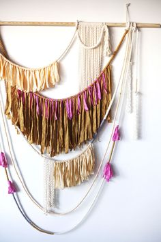 You could totally DIY (or try to) this rope and fabric wall hanging. Spotted on DesignLoveFest.