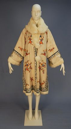 REVERSIBLE CHINESE EXPORT COAT with FUR LINING, MID 20th C. White silk embroidered with colorful flowering branches, blue and white trim bands, white rabbit fur shawl collar, cuff and buttons, side slits, reversing to all white fur.