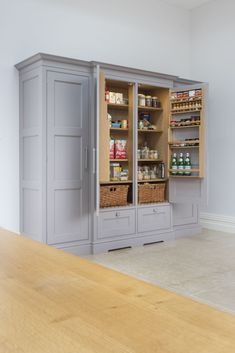 Lewis Alderson & Co, Frensham Kitchen. The fridge and freezer are cleverly concealed in a large 'dresser' style unit whilst a separate over-sized cabinet houses a double Larder with additional storage to either side Kitchen Larder Cupboard, Kitchen Storage Units, Kitchen Pantry Design, Kitchen Dresser, Diy Kitchen, Kitchen Furniture, Awesome Kitchen, Kitchen Ideas, Farmhouse Furniture