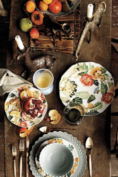 Great table setting...animal candle sticks, patterned and solid plates, wood table.