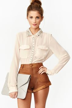 such a cute blouse! and the color of the shorts are stunning.  great pairing.     Beaded Pocket Blouse by Nasty Gal